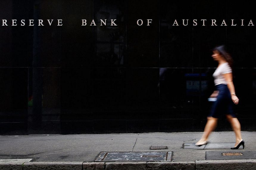 A pedestrian walking past the Reserve Bank of Australia headquarters.
