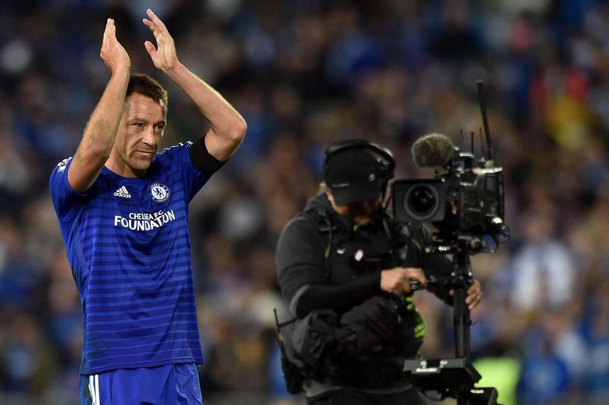 Chelsea's captain John Terry (right) acknowledges spectators' applauss at the end of a friendly match with Sydney FC in the ANZ Stadium in Sydney on June 2, 2015.
