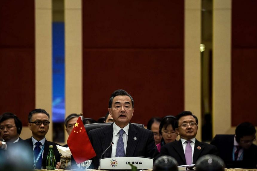 Chinese Foreign minister Wang Yi addresses the China ministerial meeting during the 48th Asean Foreign Ministers meeting at the Putra World Trade Centre in Kuala Lumpur on Aug 5, 2015.