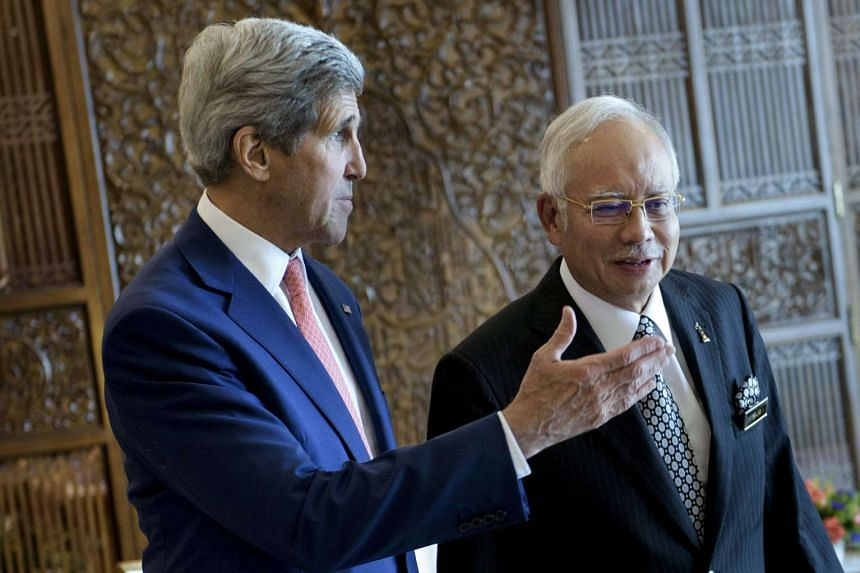 US Secretary of State John Kerry speaks with Malaysian Prime Minister Najib Razak before a meeting at the prime minister's office in Putrajaya, Malaysia, on Aug 5, 2015.