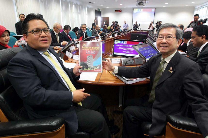 Public Accounts Committee chairman Nur Jazlan Mohamad (left) and deputy Tan Seng Giaw with an interim report on 1MDB.