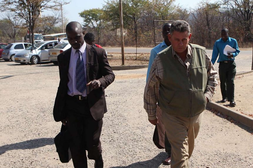 Theo Bronkhorst (right) accompanied by his lawyer Givemore Muvhuringi (left) on July 29, 2015.