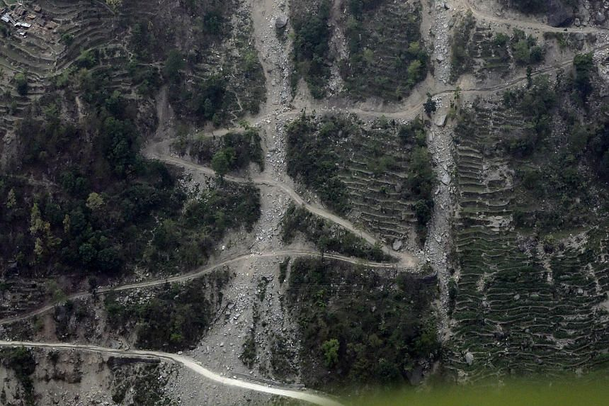 Landslides that were triggered by an earthquake in Nepal are seen in a valley leading up to the wiped out village of Langtang in north-central Nepal, on May 7, 2015.
