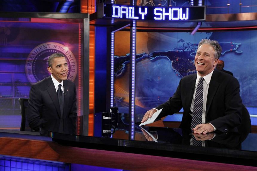 US President Barack Obama (left) at a taping of the Daily Show with Jon Stewart in 2012.
