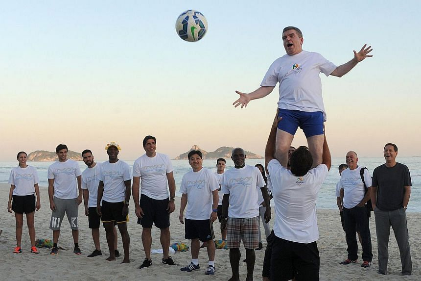 International Olympic Committee (COI) president Thomas Bach (top) taking part in an event at Barra da Tijuca Beach in Rio de Janeiro, Brazil.