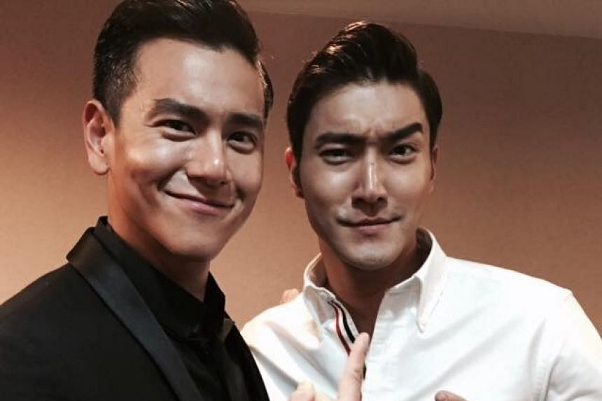 Eddie Peng (left) and Choi Si Won pose in a picture posted on Peng's Facebook page. The two stars were in Singapore on Wednesday to promote their film To The Fore.