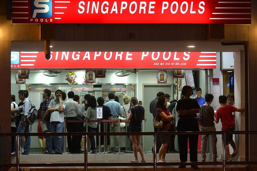 The crowd at a Singapore Pools outlet.