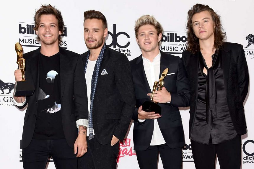 Zayn Malik's departure has not dragged the rest of One Direction down (from left) Louis Tomlinson, Liam Payne, Niall Horan and Harry Styles.
