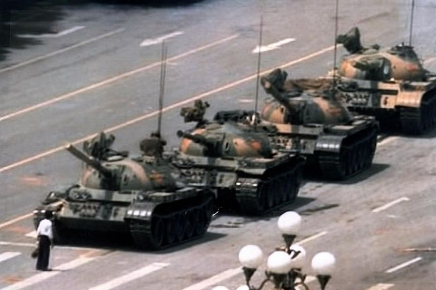 """China jailed engineer Wang Yibo 12 years for hacking into a Chinese cable TV service broadcast denunciations of the ruling Communist party - including showing the Tiananmen Square """"Tank Man"""" image."""