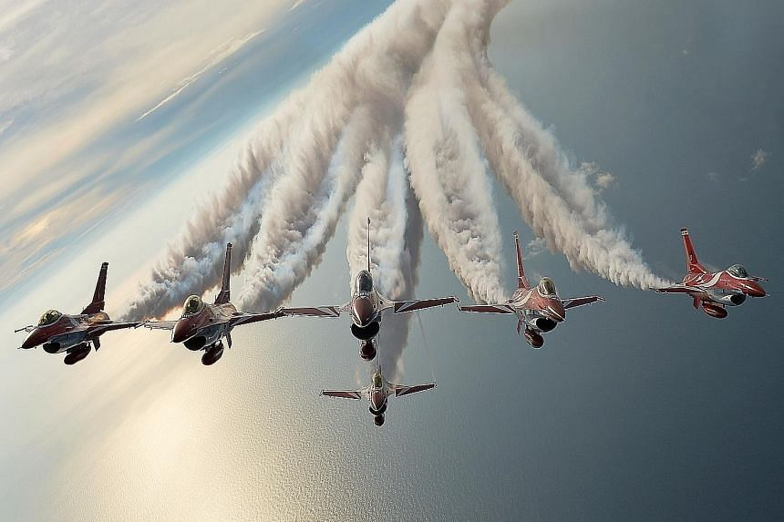Six F-16C Fighting Falcons, one united team. These are the Black Knights - the Republic of Singapore Air Force (RSAF) aerobatics team - flying in formation over the South China Sea. 	This year's team, the 14th in the RSAF's history, was formed six mo