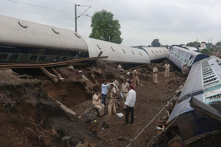 The trains, travelling in opposite directions, derailed within minutes of each other near the town of Harda (above) at about 11.30pm on Tuesday. They appear to have been hit by a sudden surge of water on the swollen Machak river. Roughly 300 people w