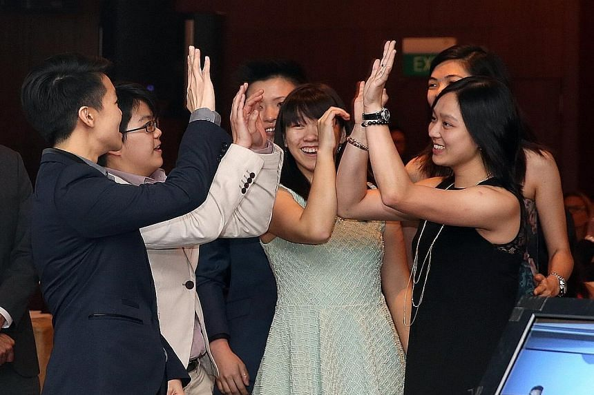 From left: Shayna Ng, Cherie Tan, New Hui Fen, Joey Yeo, Daphne Tan (back) and Jazreel Tan celebrating their Team of the Year (event) award.
