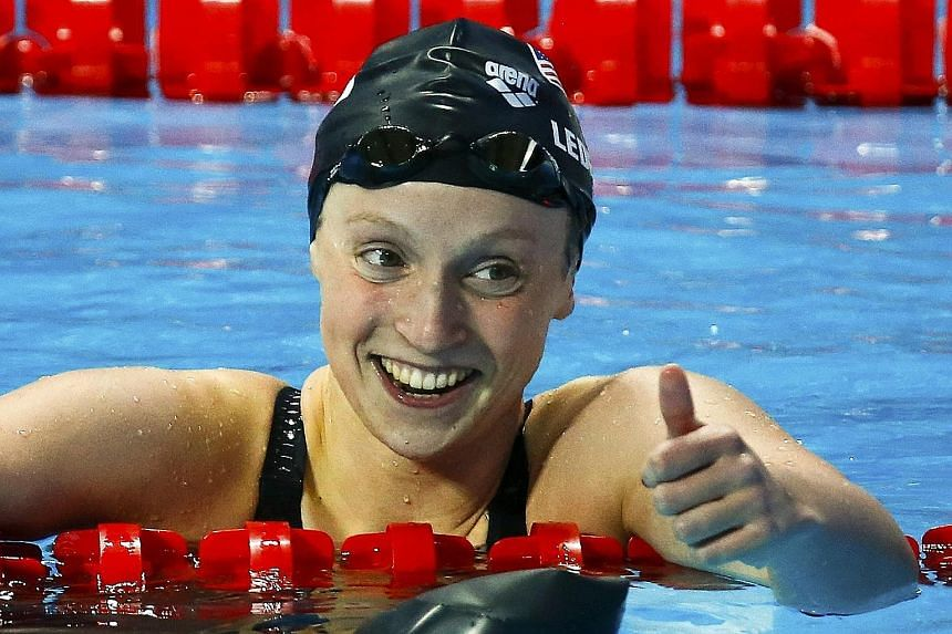 A joyous Katie Ledecky (above) after winning the 200m freestyle and Laszlo Cseh en route to his 200m butterfly victory.