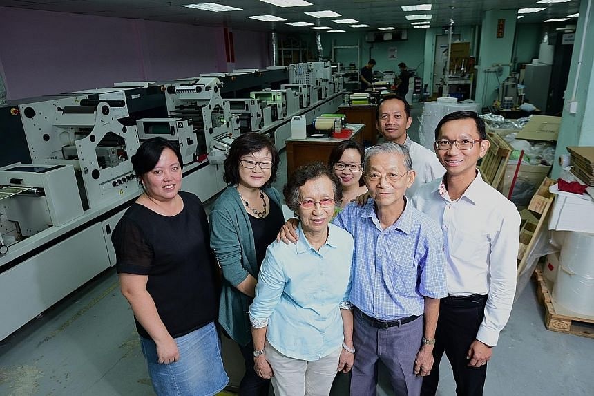 Front row: Winson Press founder Tan Hock Beng and his wife Ong Siew Yong and their son, chief executive Tan Jit Khoon. Behind them are their employees (from left): costing and purchasing manager Jessie Chan, customer service officer Teo Siew Lay, cus