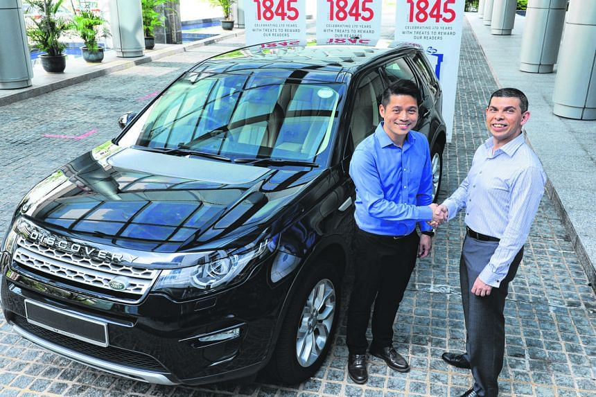 Wearnes Automotive managing director Victor Kwan (at left) handing over a Land Rover Discovery Sport to ST editor Warren Fernandez yesterday. One lucky reader will win the vehicle, which is the ST170 Treats contest's biggest and final prize.