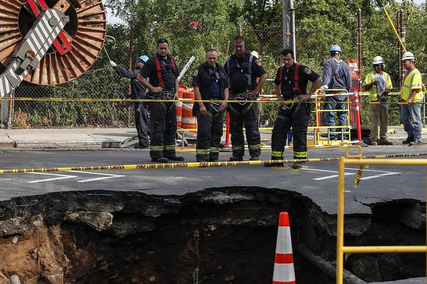 The sinkhole appeared shortly after 7am on Tuesday at an intersection in the area near Sunset Park in Brooklyn, New York. No one was hurt.