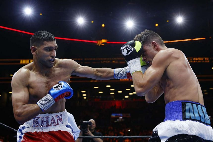 Amir Khan in action against Chris Algieri at the Barclays Center in New York City.