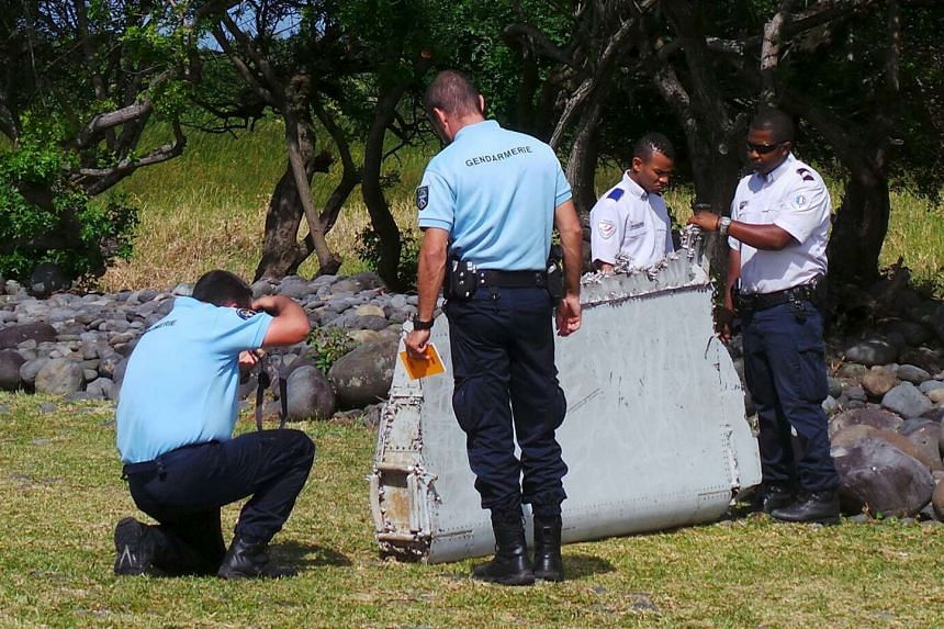 Debris found on an Indian Ocean island last week (above) is from MH370.