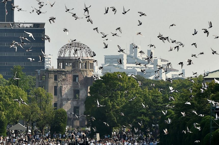 Doves fly over the Hiroshima Peace Memorial Park in western Japan on Aug 6, 2015, during a memorial ceremony to mark the 70th anniversary of the atomic bombing.