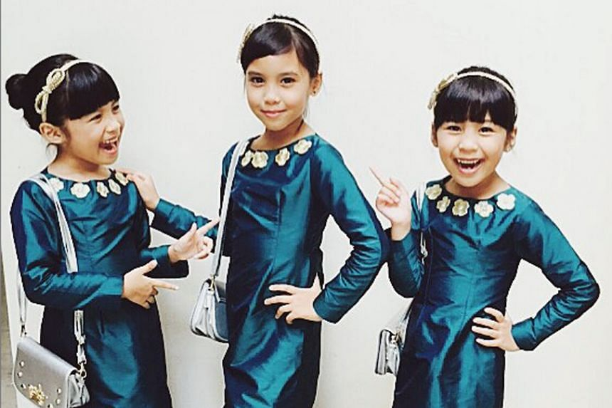 (From left) Sisters Mysha, six, Sharleez, eight, and Myreen Nadya, six, in their matching outfits.
