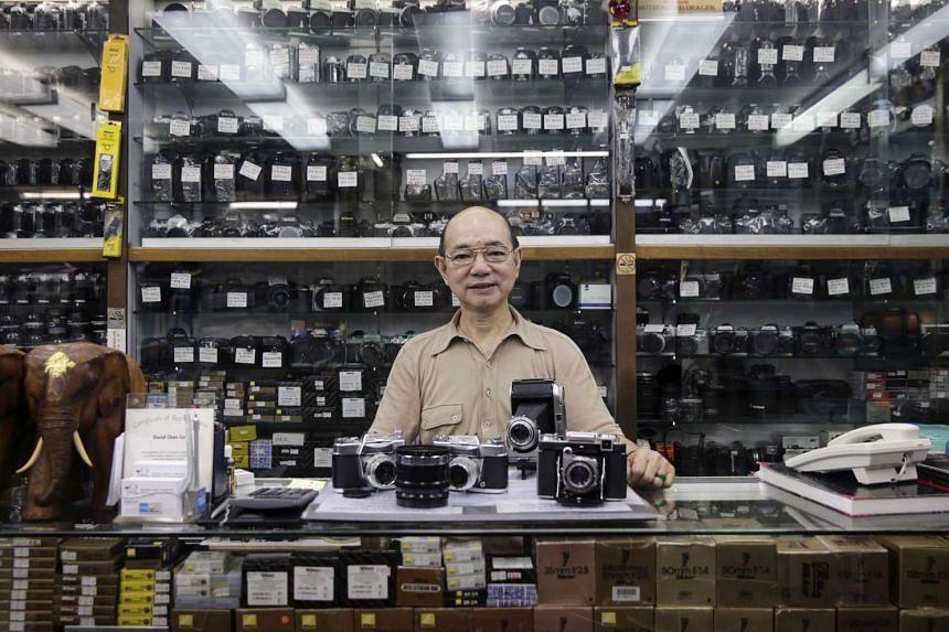 Mr David Chan, who runs a classic camera shop in Hong Kong's Tsim Tsa Tsui.
