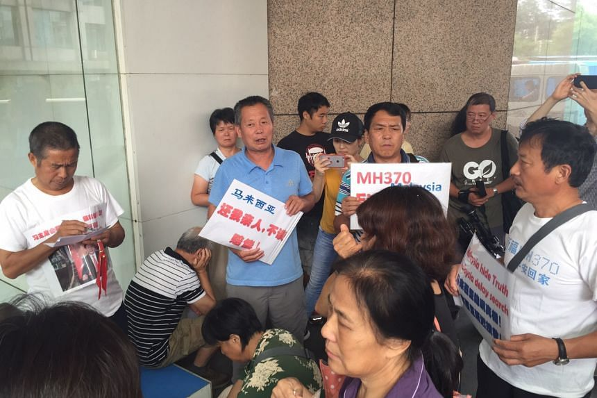 Some 20 Chinese family members gathered outside the Malaysia Airlines office in Beijing on Thursday.
