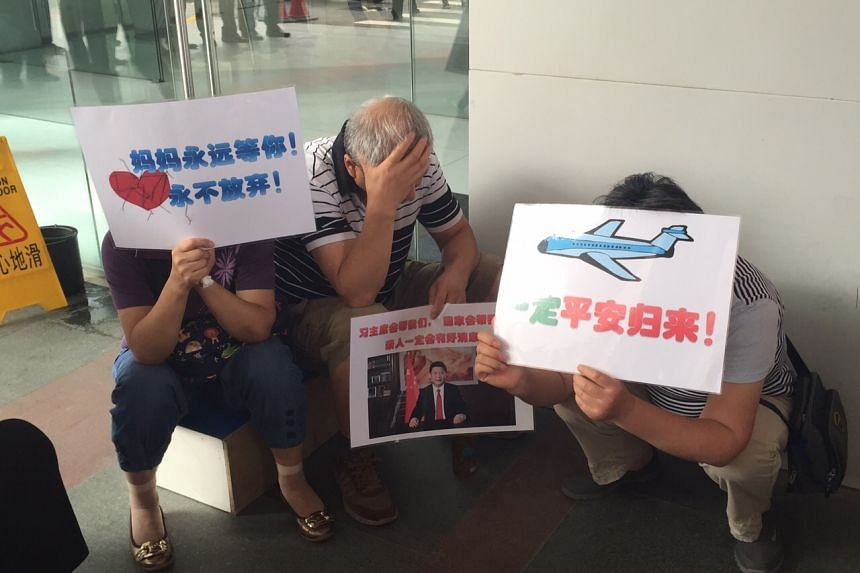 Families of Chinese passengers on Malaysian Airlines flight MH370 gathering outside the MAS office in Beijing on Aug 6, 2015.
