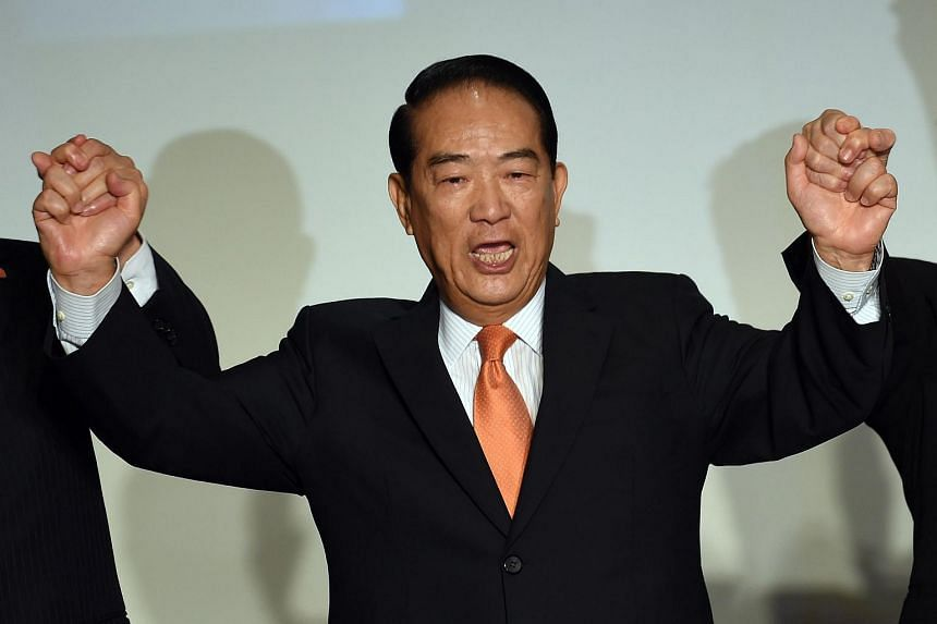 James Soong, Chairman of the People First Part, joins hands with supporters during a press conference in Taipei on Aug 6, 2015. Mr Soong will contest the presidential elections in 2016.