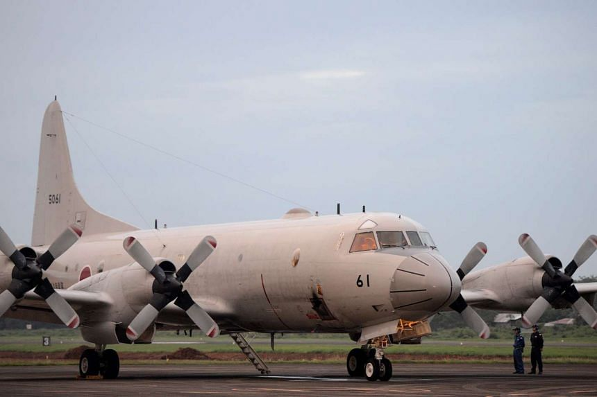 A Japanese Maritime Self-Defense Force Lockheed P-3C Orion patrol aircraft is pictured on the tarmac before taking off as part of a joint training exercise with the Philippines, at Antionio Bautista Airbase in Puerto Princesa.