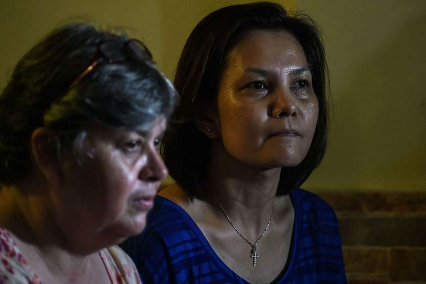 Jacquita Gonzales (left), wife of the Malaysia Airlines MH370 inflight supervisor Patrick Gomes, and Melanie Antonio (right), wife of chief steward Andrew Nari speak to the media representatives in Kuala Lumpur on Aug 5, 2015.