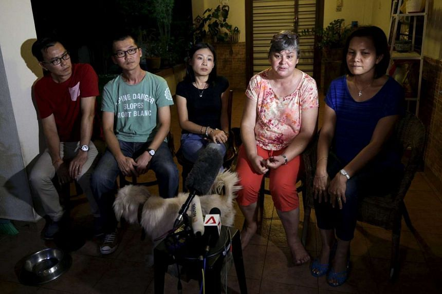 (From left)  Choi Loong Chow, husband of Flight MH370 chief stewardess Goh Sock Lay; Lee Khim Fatt (2nd L), husband of MH370 flight attendant Foong Wai Yueng; Melanie Antonio, wife of MH370 chief steward Andrew Nari; Jacquita Gomes, wife of MH370 in-