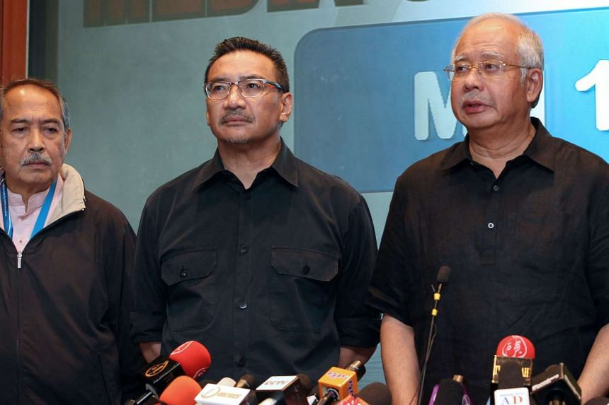 Malaysia's prime minister Najib Razak (right) and Mr Hishammuddin Hussein (centre) during a news conference about the crash of Malaysia Airlines Flight 17 on July 18, 2014.