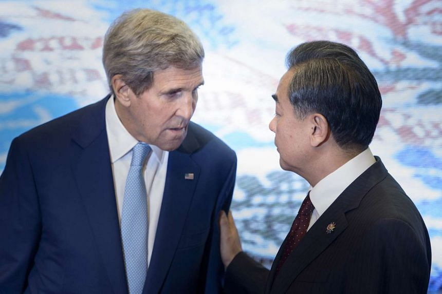 US Secretary of State John Kerry speaking with Chinese Foreign Minister Wang Yi during the East Asia Summit Foreign Ministers Meeting in Kuala Lumpur on Aug 6, 2015.