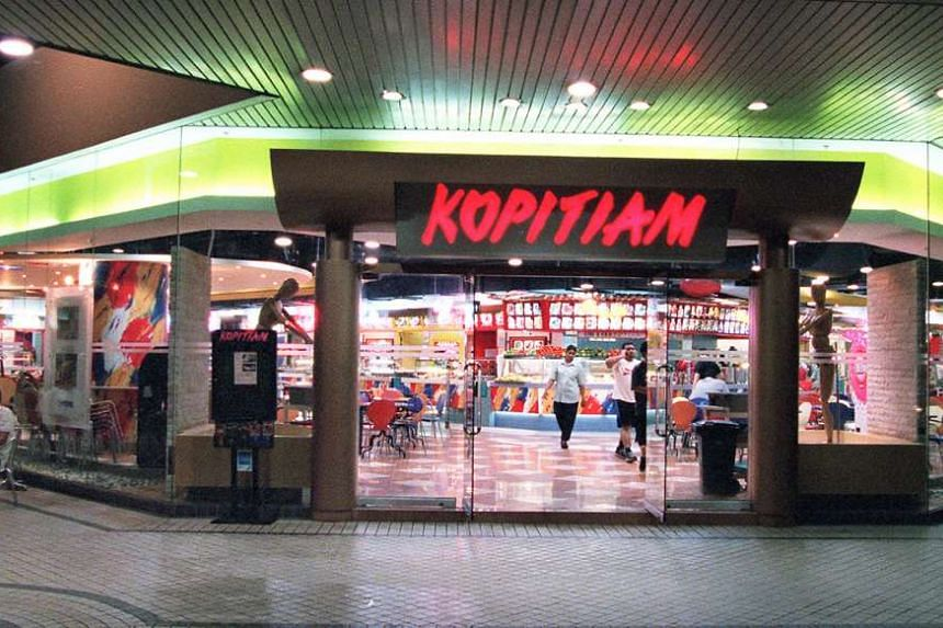 Food court chain Kopitiam has fired an employee who washed her uniform in a food stall sink after it was closed for the day.