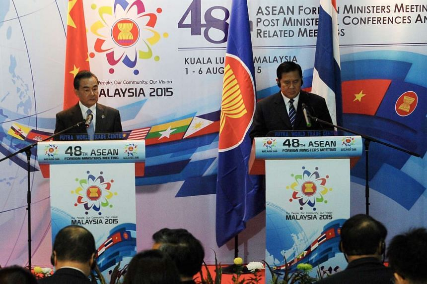 China Foreign Minister Wang Yi (left) speaking during a joint press conference with Thailand Foreign Minister Tanasak Patimapragorn at the 48th Asean Foreign Ministers' Meeting at the Putra World Trade Centre in Kuala Lumpur, Malaysia, on Aug 5, 2015