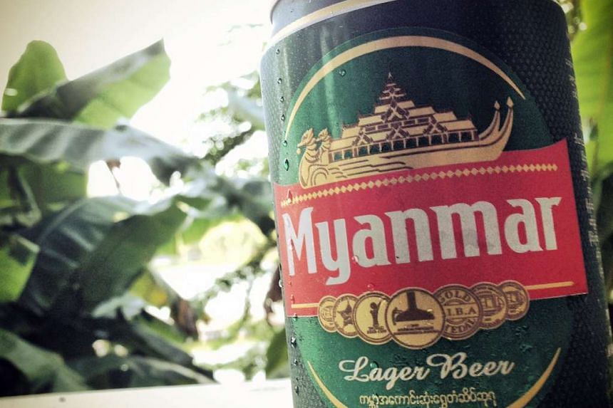 A Myanmar Beer can, a product of Myanmar Brewery Ltd., seen here. A settlement was reached over F&N's 55% stake in Myanmar Breweries with MEHL. PHOTO: SPH
