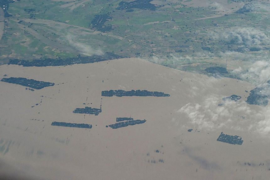 An aerial view shows massive flooding over villages near Hinthada town in Myanmar on Aug 5, 2015.