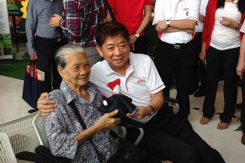 Mr Khaw with former samsui woman Wong Ah Woon, 88.