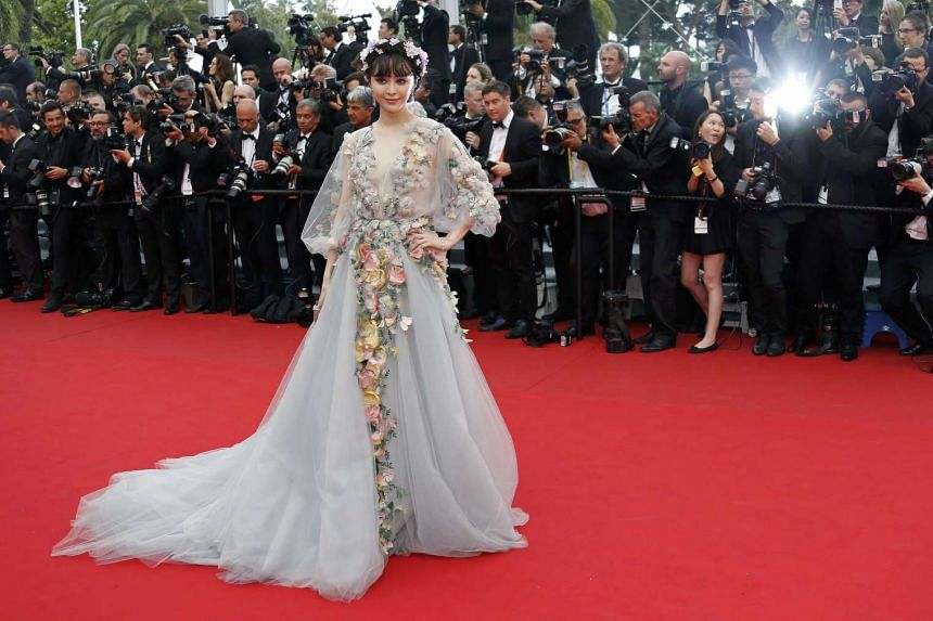 """Actress Fan Bingbing poses on the red carpet as she arrives for the screening of the film """"Mad Max: Fury Road"""" out of competition at the 68th Cannes Film Festival in Cannes, southern France, on May 14, 2015."""