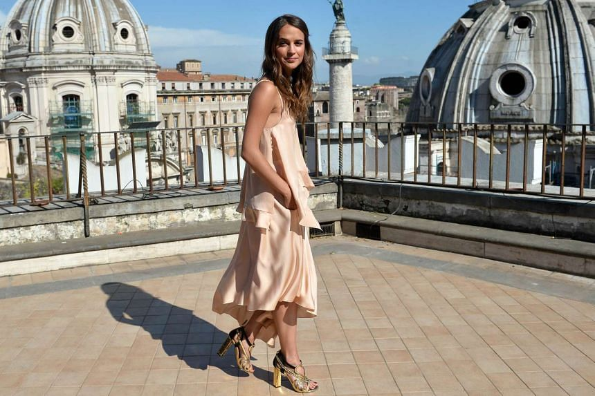 """Swedish actress Alicia Vikander poses during a photocall of the film """"The Man from U.N.C.L.E'' in Rome on May 9, 2015."""