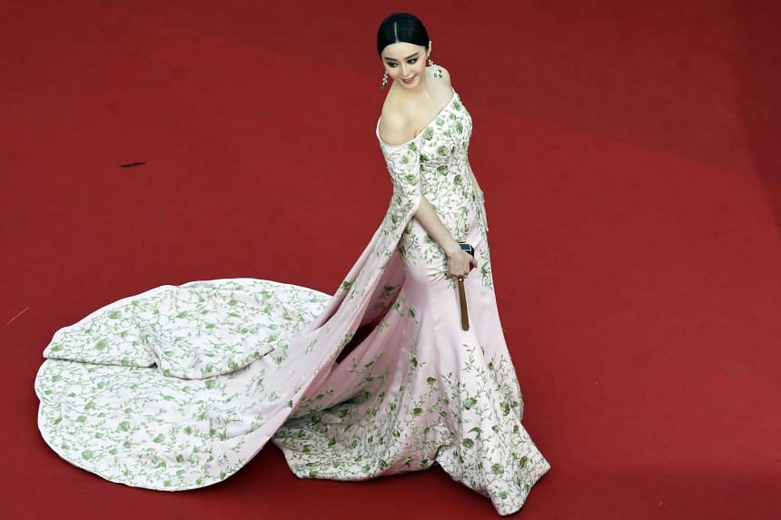 Chinese actress Fan Bingbing poses as she arrives for the opening ceremony of the 68th Cannes Film Festival in Cannes, southeastern France, on May 13, 2015.