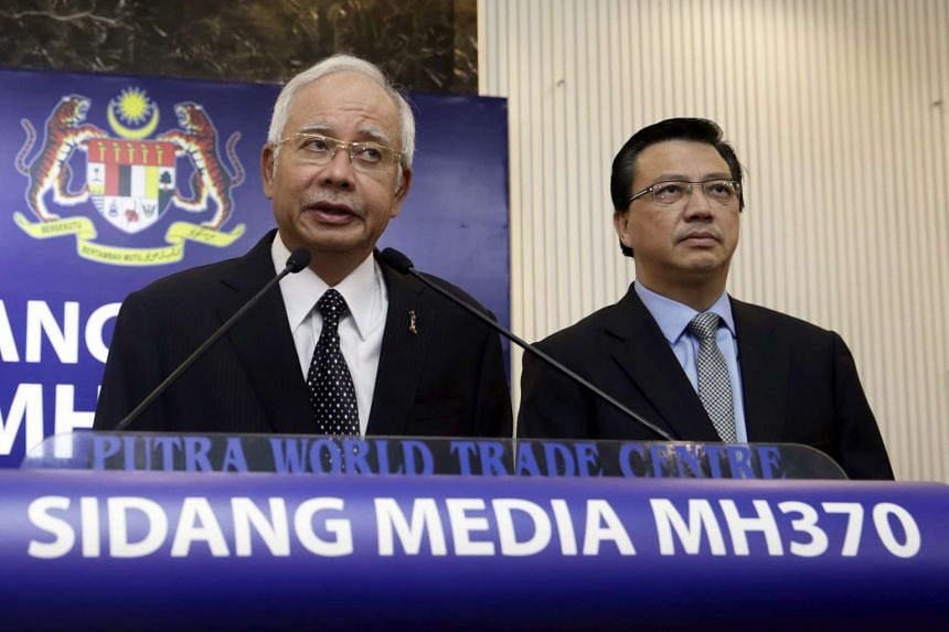 PM Najib (left) speaks during the press conference on MH370 accompanied his Transport Minister Tiong Lai (right).