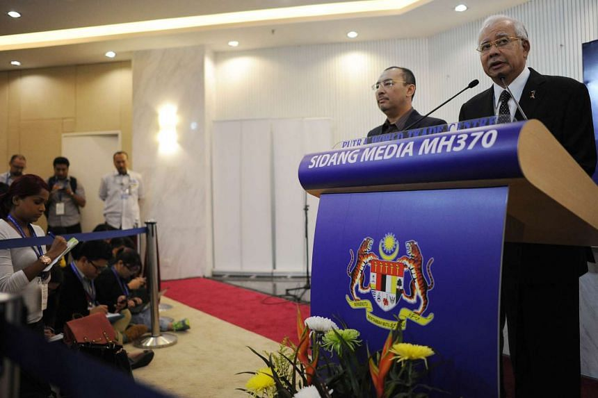 Malaysia's Prime Minister Najib Razak (right) delivering a statement on the Malaysia Airlines flight MH370.
