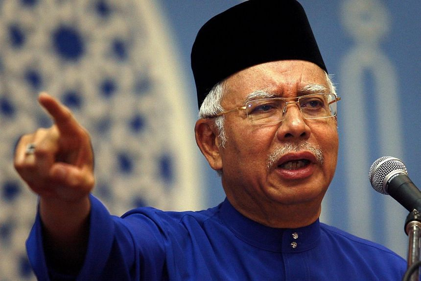 Malaysian PM Najb Razak, who is also Umno president, speaking at the Seremban Umno division annual meeting on Aug 1.