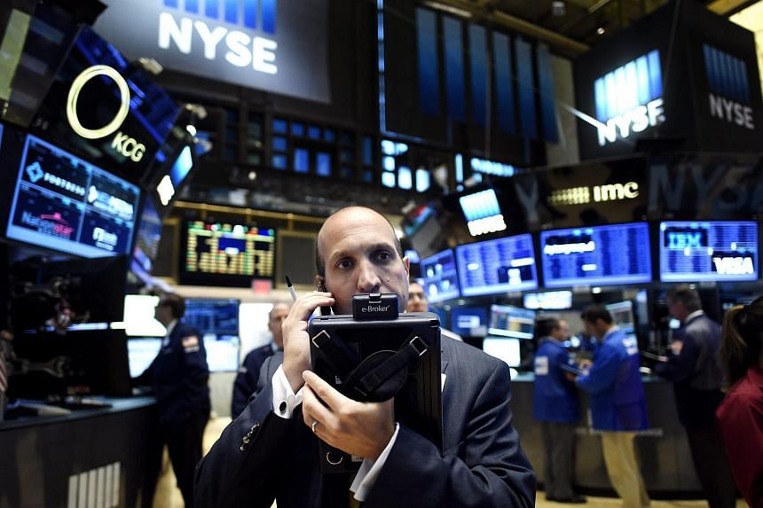 Traders on the floor of the NYSE in New York on July 30, 2015.