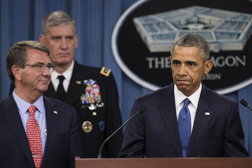 US President Barack Obama speaks alongside Secretary of Defense Ashton Carter (far left) following a meeting about the military campaign against the Islamic State on July 6, 2015.