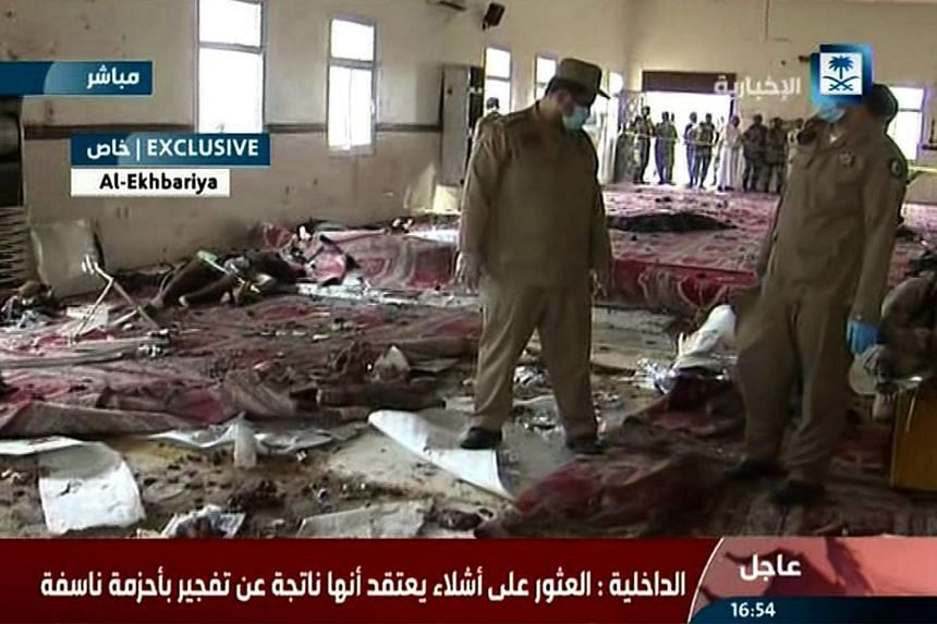 An image grab taken from Saudi Al-Ekhbaria TV on Aug 6, 2015 shows Saudi security forces inspecting the site of an alleged suicide bombing at a mosque in the city of Abha, near the border with Yemen.