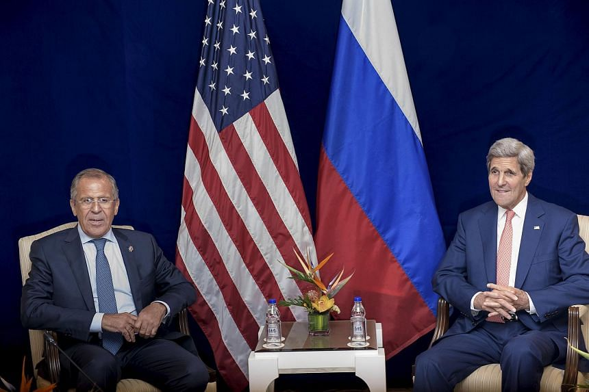 Russia's Foreign Minister Sergei Lavrov (left) and US Secretary of State John Kerry sit next to each other before a bilateral meeting in Kuala Lumpur, Malaysia on Aug 5, 2015.