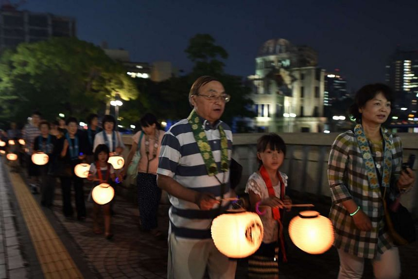 People taking part in a ceremony near the Atomic Bomb Dome in Hiroshima yesterday, a day ahead of the 70th anniversary of the US bombing of the Japanese city during World War II.
