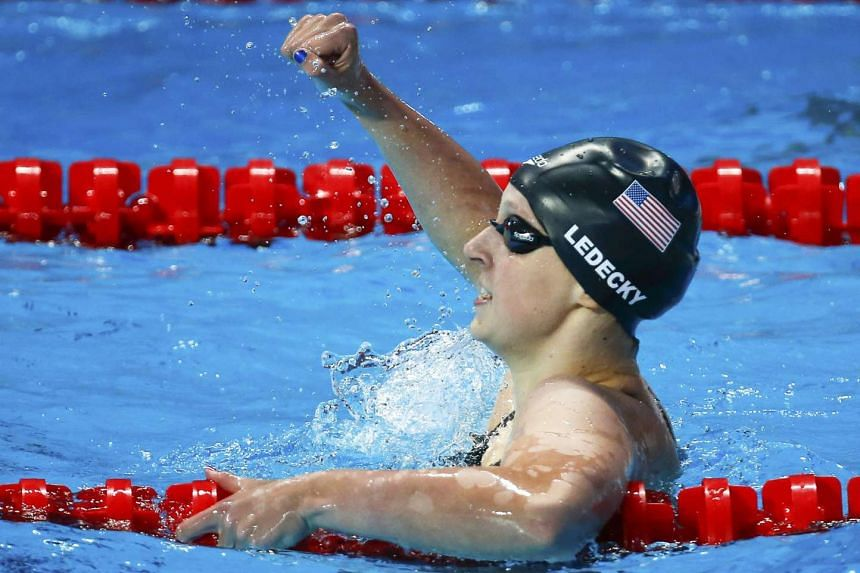 Ledecky celebrates after winning in the women's 200m freestyle final.